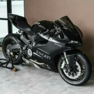 To own an all black Ducati